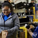 smiling manufacturing employees